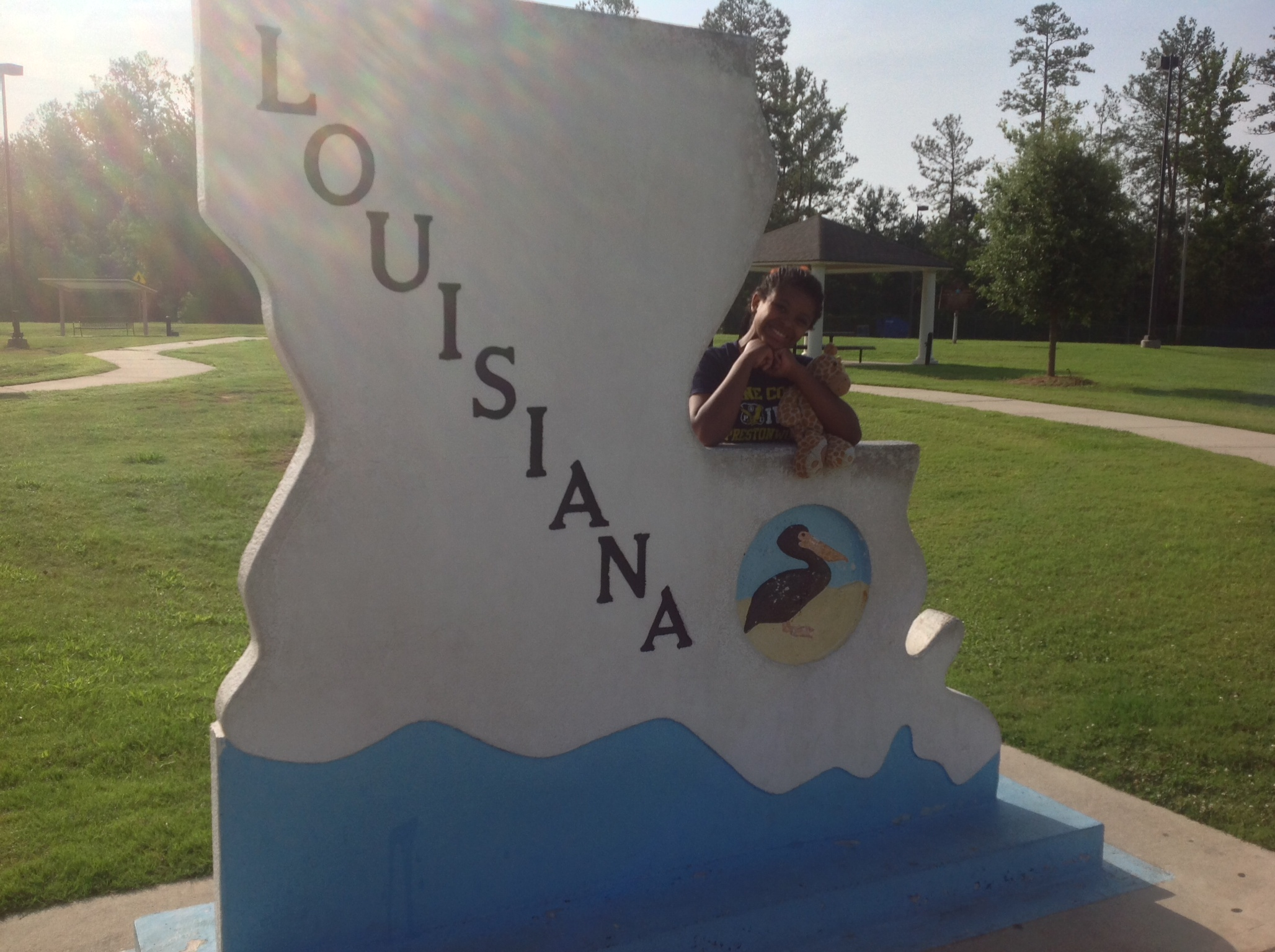 Teddy and Cub #2 with the Louisiana State sign.