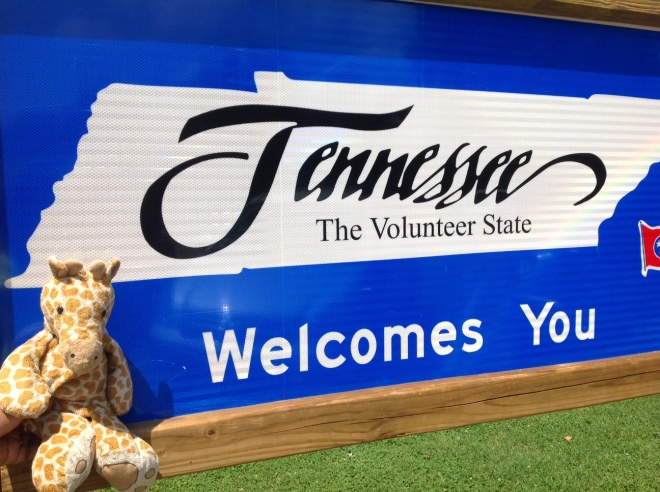 "Our Road Trip Mascot ""Teddy the Giraffe"" Welcomes us to Tennessee the Volunteer State."